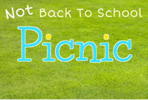 """Not Back To School Picnic"". The words appear against a background of green grass. ""Not"" is at an angle, as if added after ""Back To School"". Picnic is in sky blue. The dots of the letter i are in yellow like the sun."